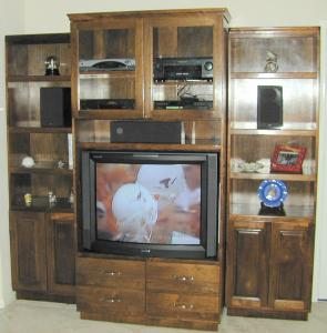 Narrower Bookcases Are On Either Side Of The Electronics Cabinet In This Entertainment Wall Each Bookcase Is 24 Inches Wide And 80 Tall